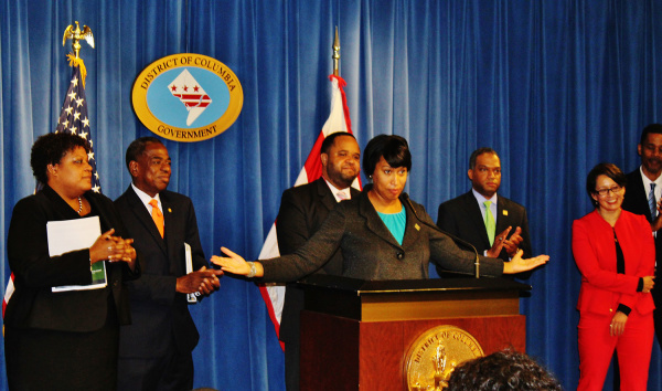 From left, Courtney Snowden, Vincent Orange, Rashad Young, Mayor Bowser, Brandon Todd and Ana Harvey