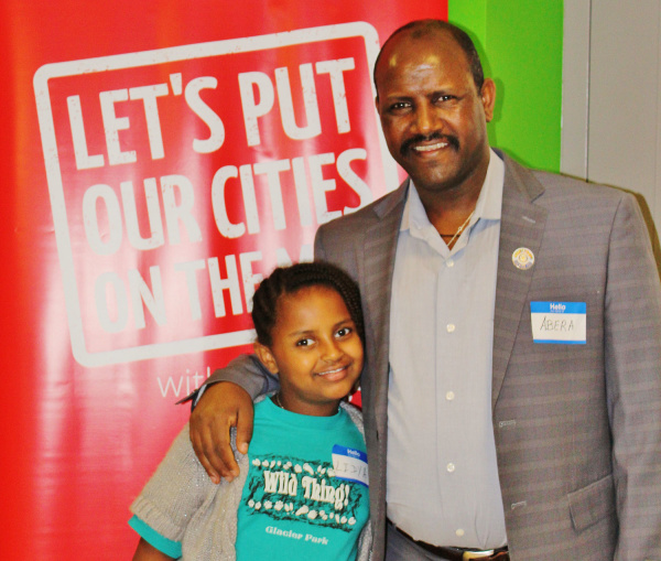 Local business owner Abera Abebe and his daughter Lydia
