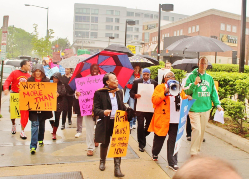 Liz Davis, center in black, and Jim Leonard, far right in green Wilson hoody lead May 5 march past Wilson and Deale middle school.