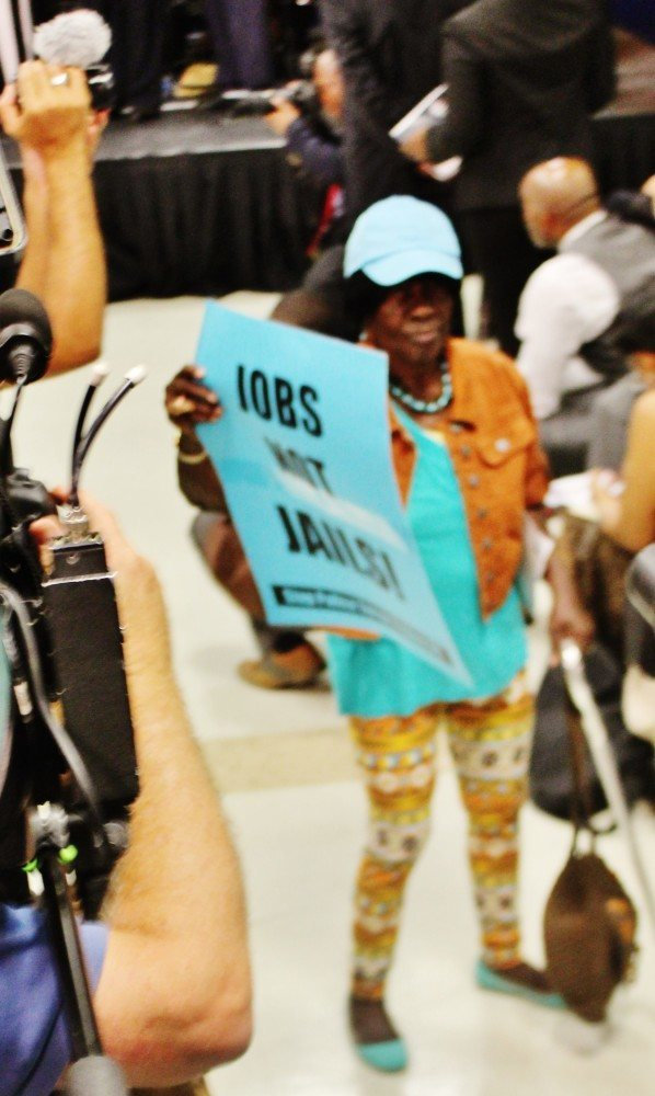 """Ghetto grandma,"" 90-year old community activist Elaine Carter, adds her voice and poster to Thursday's protests. (Credit: Malcolm Lewis Barnes)"
