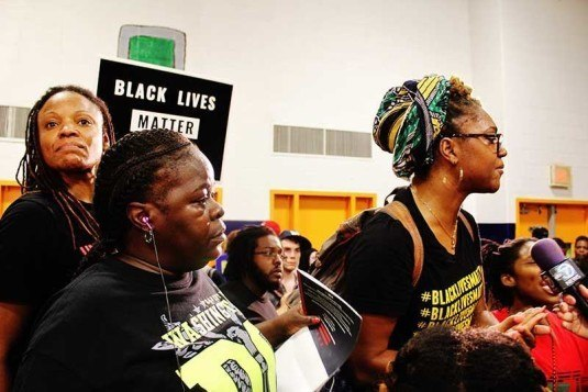BLM firebrand Erika Totten leads other female protesters. (Credit: Malcolm Lewis Barnes)