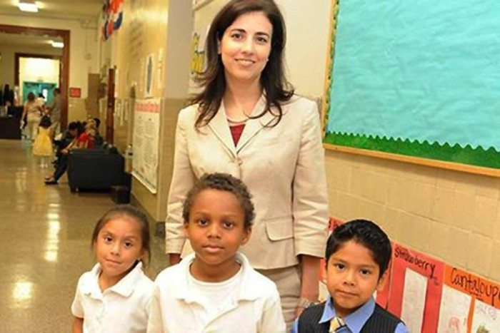Janeece Docal, DCPS 2014 Principal of the Year with students. (Image via Facebook)
